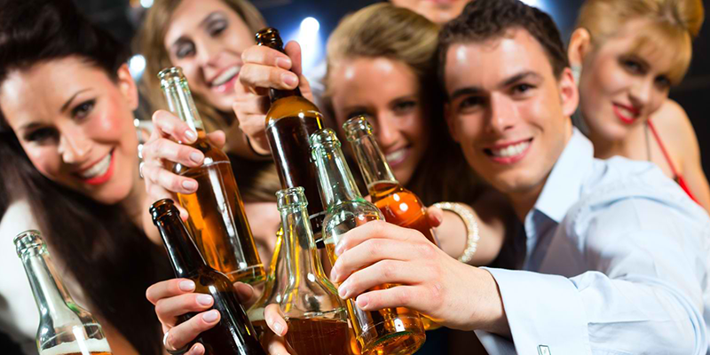 young-people-in-club-or-bar-drinking-beer-out-of-a-beer-bottle-and-have-fun2